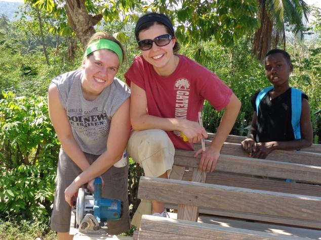 Jessica Bertsch and Audrey Reinhard working on benches