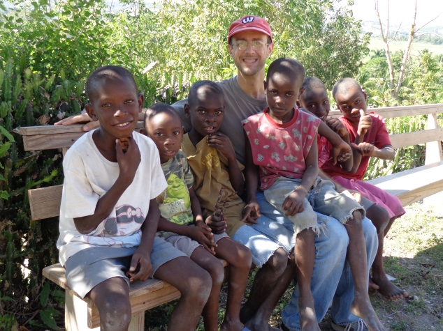 Sean Christenson with some Haitian children