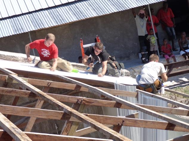 Josh Fiechter, Brent, Darin Fiechter putting tin on