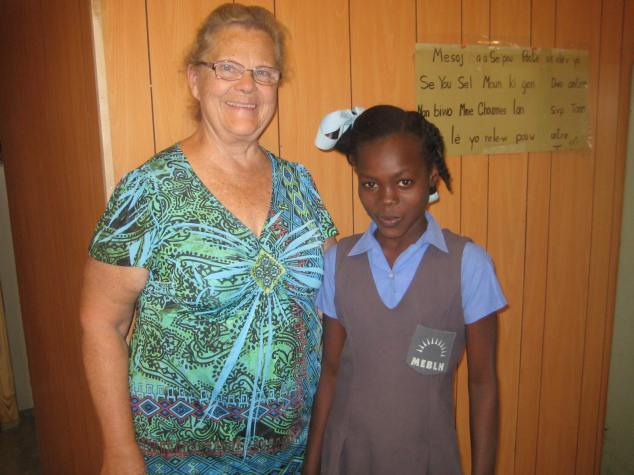 Connie with a sponsor child