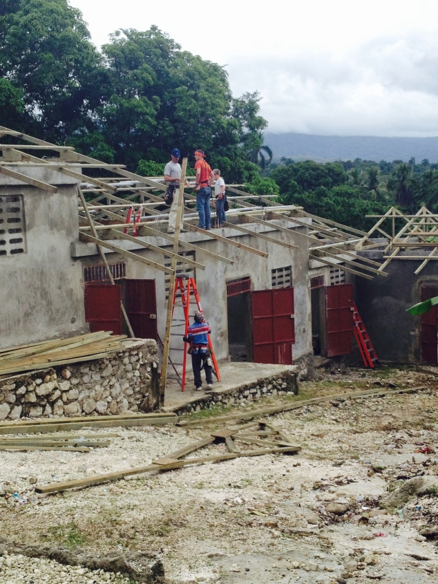 After arriving on Saturday, the men began building trusses and the ladies started on the bench.