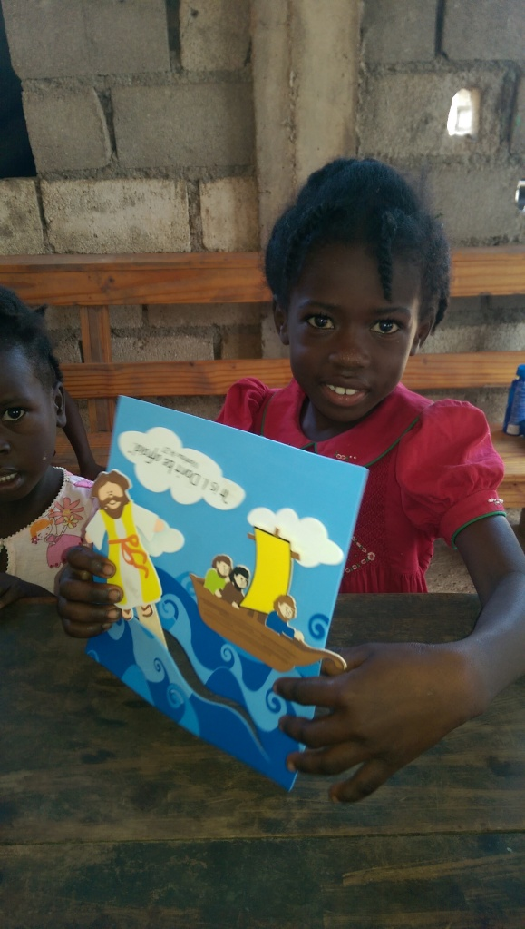 While the boys played soccer, we took the young girls and did crafts.  I'm not sure who sent these crafts down, but the Haitian girls sure enjoy them!