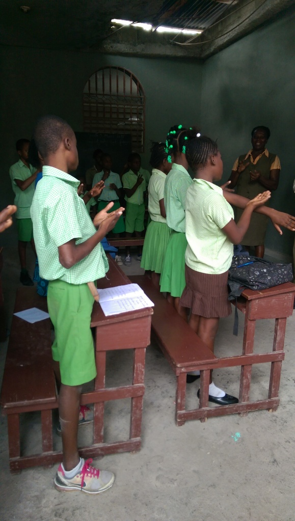 "The children at this deaf school are so precious. It's awesome that this school can be supported so that these deaf children can receive an education.  In this picture they are ""singing"" us a song sign language."