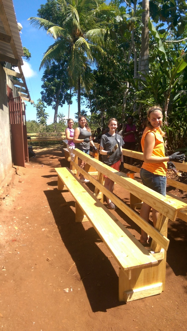 The girls working hard on the 10 new church benches.