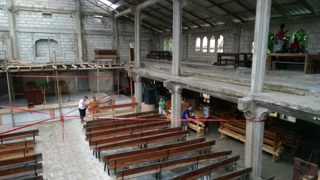 We had to move inside once the rain came. God provided enough of the roof covered that we could still work!