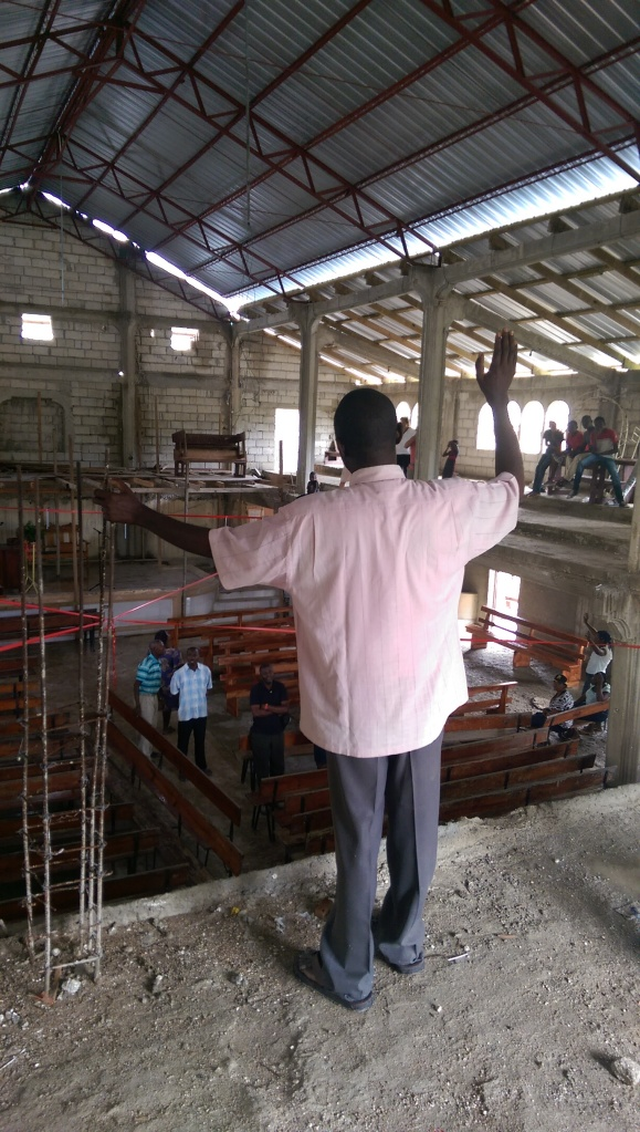 As the last pieces of tin were being places, the pastor, along with several church members stood under the new roof while giving God praise.  It was a blessing to hear the prayers of thanks and songs on joy as they celebrated the finished church!