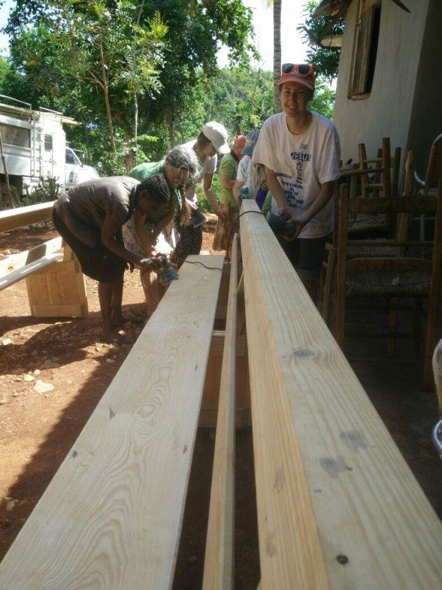 After the 20 benches were built, it was on to sanding!  The Haitian teens were eager to help.