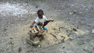 The simplest of toys are the best. This little boy started building using the scraps of wood from the trusses.
